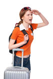 Smiling girl with backpack and suitcase Royalty Free Stock Photos