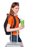 Smiling girl with backpack and suitcase Royalty Free Stock Image