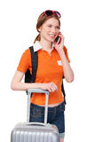 Smiling girl with backpack and suitcase stock image