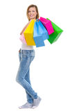 Smiling girl with bags looking on copy space Royalty Free Stock Photos