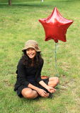 Smiling girl with balloon Royalty Free Stock Photo