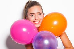 Smiling girl and balloons Royalty Free Stock Photo