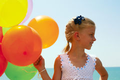 Smiling girl with balloons Royalty Free Stock Image