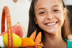 The smiling girl with basket Royalty Free Stock Photo