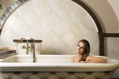 Smiling girl in a bathtub Royalty Free Stock Photos