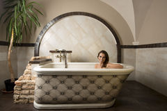 Smiling girl in a bathtub Royalty Free Stock Images