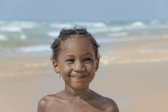 Smiling girl at the beach, six years old Royalty Free Stock Image