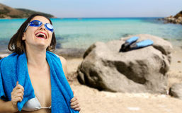 Smiling girl in beachwear with swimming goggles over white  back Stock Photo