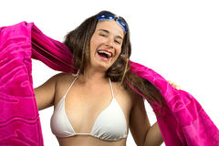 Smiling girl in beachwear with swimming goggles and towel Stock Image