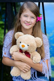 Smiling girl with bear Royalty Free Stock Photo