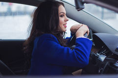 Smiling girl behind the wheel Stock Images