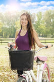 Smiling girl with bicycle Stock Photo