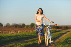 Smiling Girl with Bicycle Stock Photos