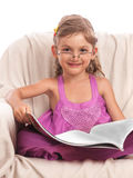 Smiling girl with big book Stock Image