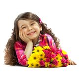 Smiling girl with big bouquet of flowers. Lying on floor. Mothers day, happiness concept. Isolated white background Stock Image