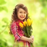 Smiling girl with big bouquet of flowers. Spring, Mothers day, family holiday, Happiness concept Stock Photos