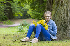 Smiling girl with big bouquet of spring flowers Royalty Free Stock Images