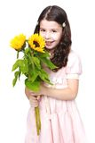 Smiling girl with big bouquet of yellow flowers Stock Photo