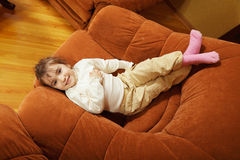 Smiling girl in big chair Stock Image