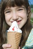 Smiling girl with big ice-cream Stock Images