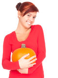 Smiling girl with big orange pumpkin Royalty Free Stock Photos