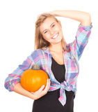 Smiling girl with big orange pumpkin Stock Photo