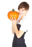 Smiling girl with big orange pumpkin Stock Images