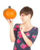 Smiling girl with big orange pumpkin Royalty Free Stock Images