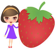 Smiling girl with a big strawberry Stock Images