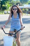 Smiling girl on a bike royalty free stock photography