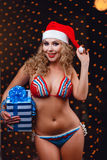 Smiling girl in a  bikini with christmas gift Stock Images