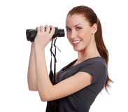 Smiling girl with binoculars Stock Images
