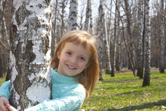 Smiling girl in birch grove Royalty Free Stock Images