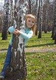 Smiling girl in birch grove Royalty Free Stock Image