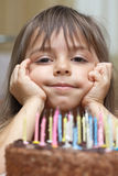Smiling girl and birthday cake Royalty Free Stock Images