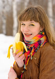 Smiling girl biting a banana Stock Photo