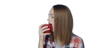 Smiling girl biting big green pear apple stock video footage