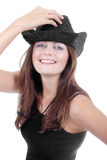 Smiling girl in black cowboy hat Stock Photo