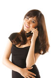 Smiling girl in black with mobile Royalty Free Stock Photos