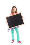 Smiling girl with a blackboard. Royalty Free Stock Image