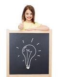 Smiling girl with blackboard showing thumbs up Stock Photos