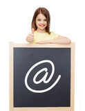 Smiling girl with blackboard showing thumbs up Royalty Free Stock Image