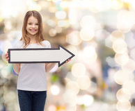 Smiling girl with blank arrow pointing right Stock Photography