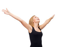 Smiling girl in blank black tank top waving hands Stock Photography