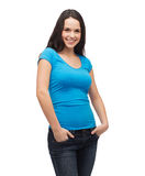 Smiling girl in blank blue t-shirt Stock Photos