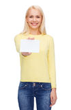 Smiling girl with blank business or name card Royalty Free Stock Photography