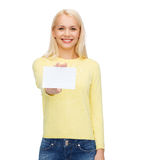Smiling girl with blank business or name card Stock Images