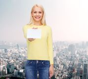 Smiling girl with blank business or name card Stock Photography