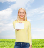 Smiling girl with blank business or name card Stock Image