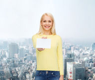 Smiling girl with blank business or name card Royalty Free Stock Image